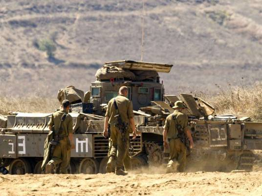 grey «الدفاع الإسرائيلية» تتجه لتسريح آلاف العمال لتخفيض النفقات