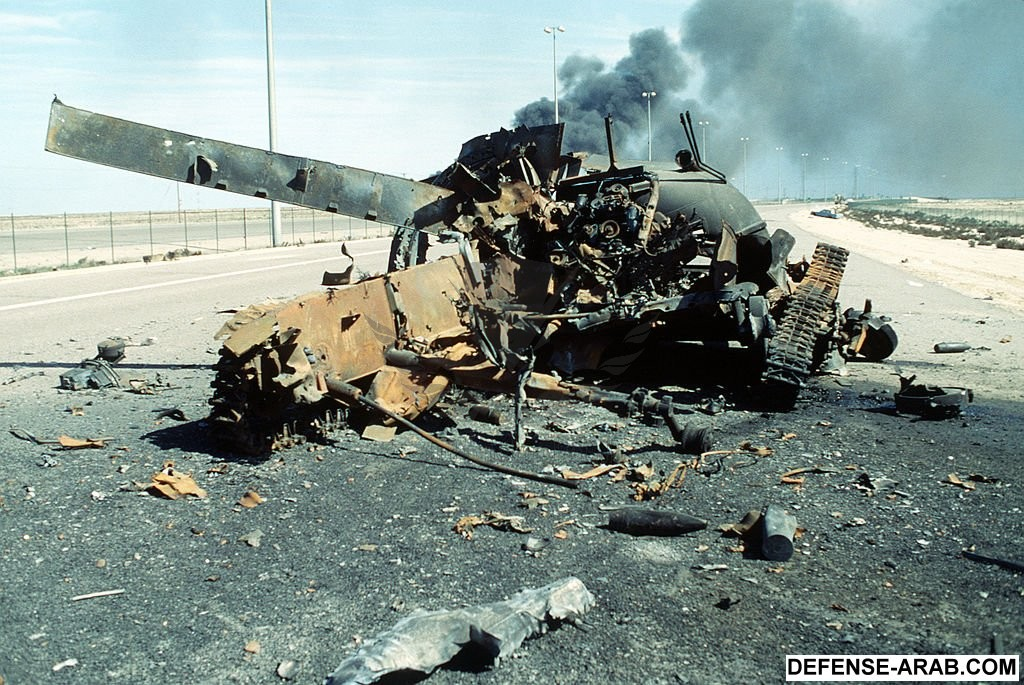 1024px-A_destroyed_iraqi_main_battle_tank_on_the_Highway_of_Death.JPEG