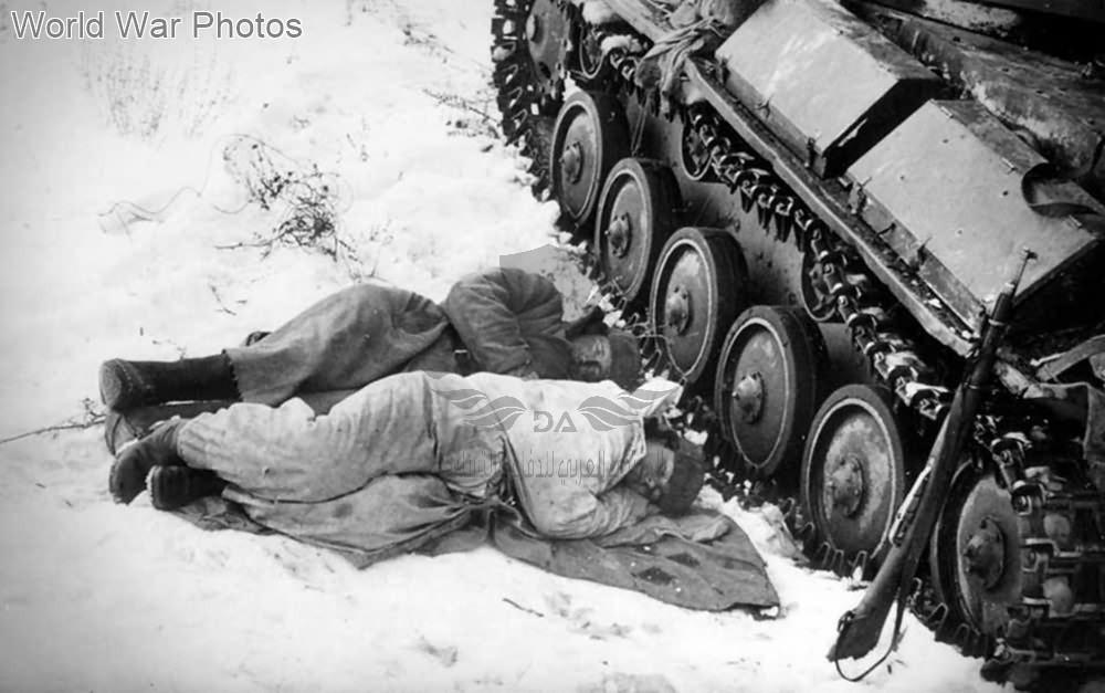 Tank_crew_sleep_near_their_T-70.jpg