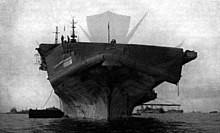 220px-Flight_deck_of_USS_Bennington_(CV-20)_damaged_by_typhoon,_12_June_1945.jpg